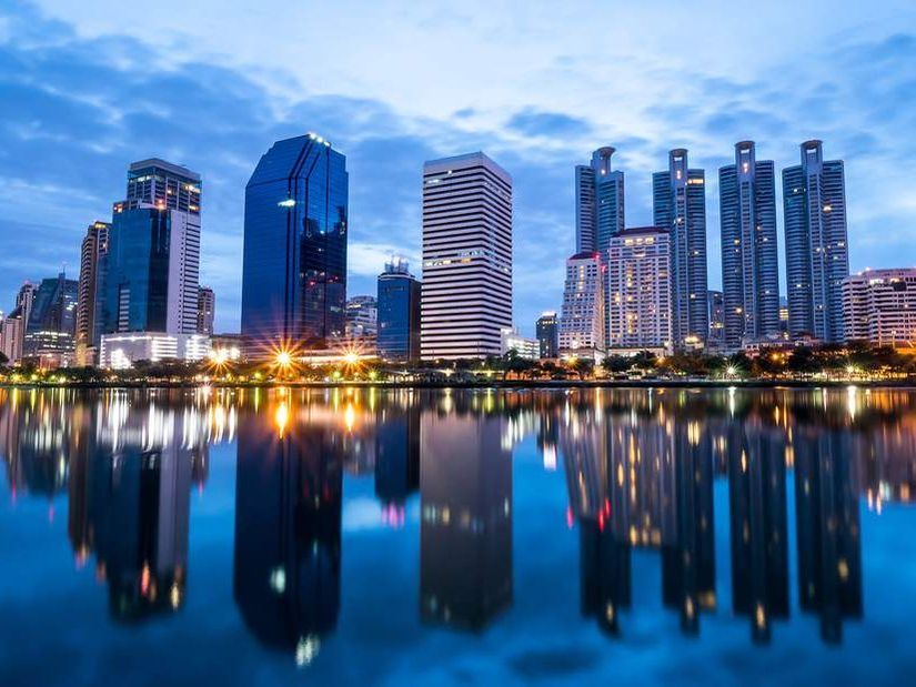 Night light cityscape view with modern building in the park beside lake at Bangkok, Thailand